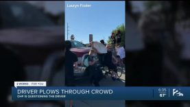 Driver-plows-through-crowd-of-protesters-on-I-244-attachment
